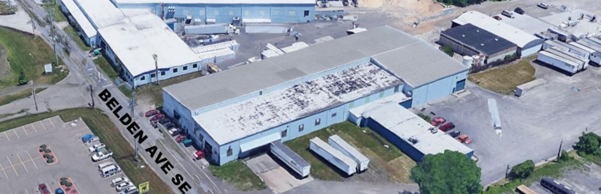 HIGH BAY CRANED INDUSTRIAL BUILDINGS FOR SALE OR LEASE